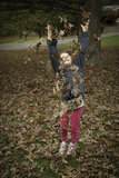 Little Girl Throws Leaves Royalty Free Stock Photography