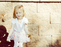 Little Girl Throws Leaves with Wind Blowing Her Hair Royalty Free Stock Photos