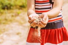Little girl throws Stock Image