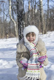 Little girl throws up snow Royalty Free Stock Images