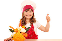 Little girl with thumb up and decorated salad Stock Image