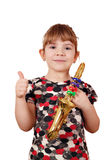 Little girl with thumb up and saxophone Royalty Free Stock Images