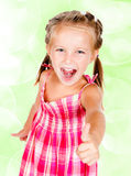 Little girl with thumbs Royalty Free Stock Image
