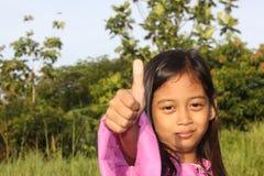 A Little Girl Thumbs Stock Photo