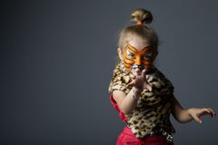 Little girl with tiger costume Royalty Free Stock Photography