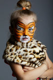 Little girl with tiger costume Stock Images
