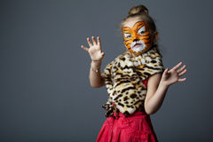 Little girl with tiger costume Royalty Free Stock Photo