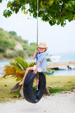 Little girl on tire swing Stock Photos