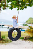 Little girl on tire swing Stock Images