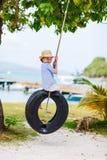 Little girl on tire swing Stock Images