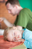 Little girl tired and fall asleep in cafe Stock Image