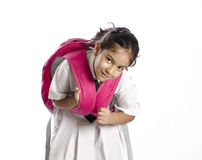 A little girl tired of lifting heavy bag Royalty Free Stock Images