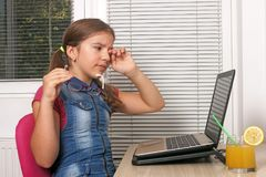 Little girl are tired of using laptop Royalty Free Stock Image