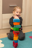 Little girl is to be glad about a tower of bricks Royalty Free Stock Photo