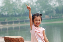 Little girl to do the victory sign stock photo