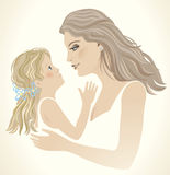 A little girl and to mom. Royalty Free Stock Photo