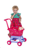 Little girl or toddler with a toy pram Royalty Free Stock Images