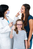 Little girl together with older sister ready for dental check up Royalty Free Stock Photo