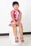 The little girl toilet Stock Images