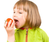 Little girl with tomatoes Stock Photo