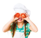 Little girl with tomatoes royalty free stock images