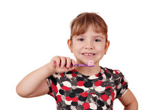 Little girl with tooth brush Stock Photos