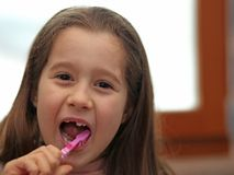 Little girl without a tooth while brushing teeth Royalty Free Stock Photos