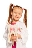 Little girl with tooth dummy playing dentist Royalty Free Stock Photography