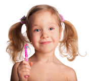 Little girl with toothbrush Stock Image