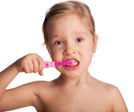 Little girl with toothbrush Royalty Free Stock Photos