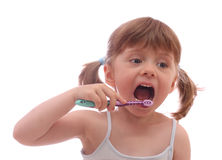 Little girl with toothbrush Stock Photo