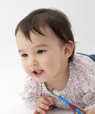 Little girl with toothbrush in her hand on white background Royalty Free Stock Image