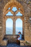 Little girl on the top of St. Hillarion castle in North Cyprus royalty free stock photo