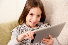 Little girl  with touch tablet computer Stock Images