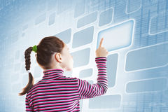 Little girl touching a button of virtual screen Royalty Free Stock Images