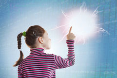 Little girl touching a clot of energy. Conceptual image about new technologies Royalty Free Stock Photo