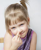 Little girl touching her nose Royalty Free Stock Photo