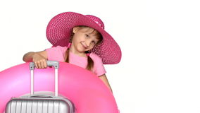 Little girl tourist with travel suitcase showing thumb up sign. Little girl tourist in wide brimmed summer hat with travel suitcase and a ring on it, showing stock video