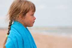 Little girl with towel Stock Images