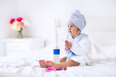 Little girl in a towel after bath Stock Image