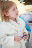 Little girl in a towel after bath in the sea Stock Photography