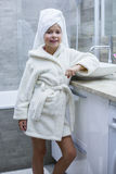 Little girl in a towel and a bathrobe Royalty Free Stock Photo