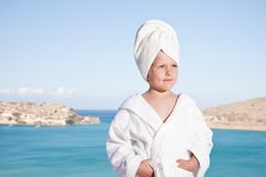 Little girl with towel on head in white bathrobe Royalty Free Stock Image