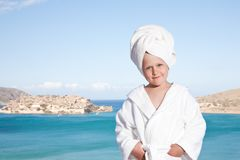 Little girl with towel on head in white bathrobe Royalty Free Stock Photography
