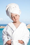 Little girl with towel on head in white bathrobe Royalty Free Stock Photos