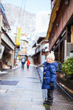 Little girl at town in Japan Royalty Free Stock Photo
