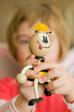 Little Girl with toy. Little girl with  wooden toy , the bee Royalty Free Stock Photography