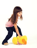 The little girl and a toy Stock Photography