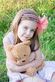 Little girl with a toy Stock Photography