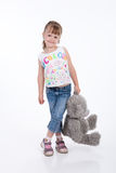 Little Girl WIth Toy. Little girl with a toy on white background royalty free stock images